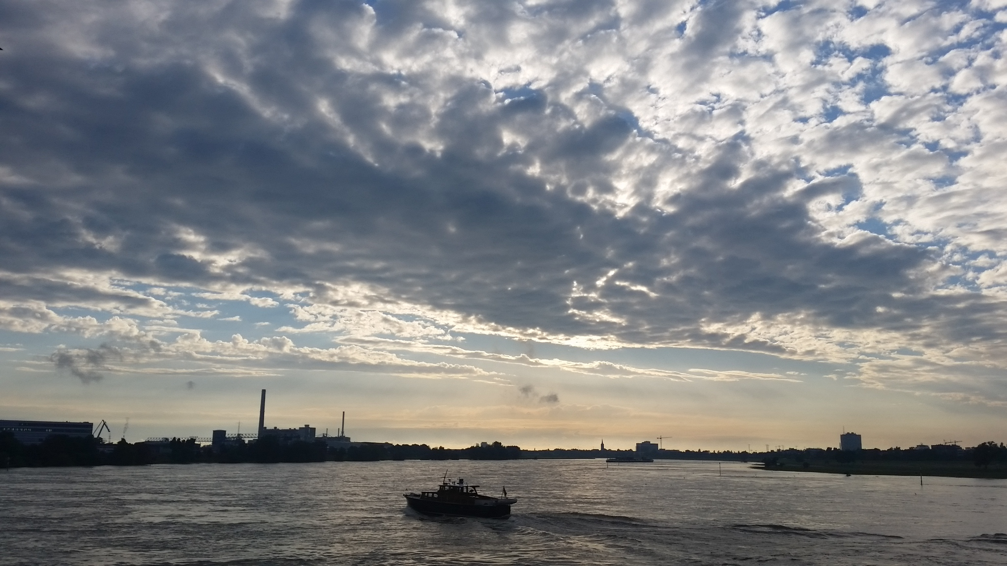 The sky lights up over the Rhein River at Dusseldorf.