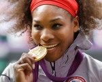 Serena Williams sinks her teeth into her 2012 Olympics Games gold medal but says she is sad the likes of Jason Day is not competing in Rio