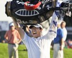 Y.E. Yang, of South Korea, holds up his golf bag after winning the 91st PGA Championship at the Hazeltine National Golf Club in Chaska, Minn., Sunday, Aug. 16, 2009. (AP Photo/Jeff Roberson) ORG XMIT: PGA214