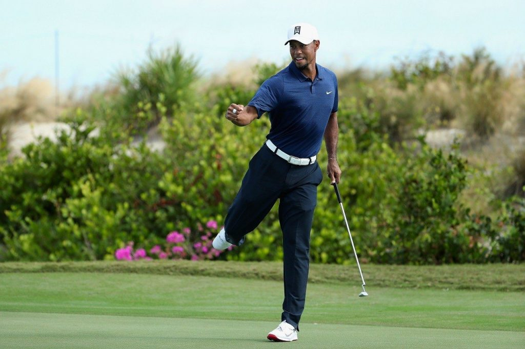 Tiger Woods with the first fist pump at the 2016 Hero World Challenge holing a 25-foot par putt at 16.