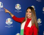 Lavinia Biagiotti Cigna proudly points to the logo  promoting Italy at the host of the 2022 Ryder Cup.
