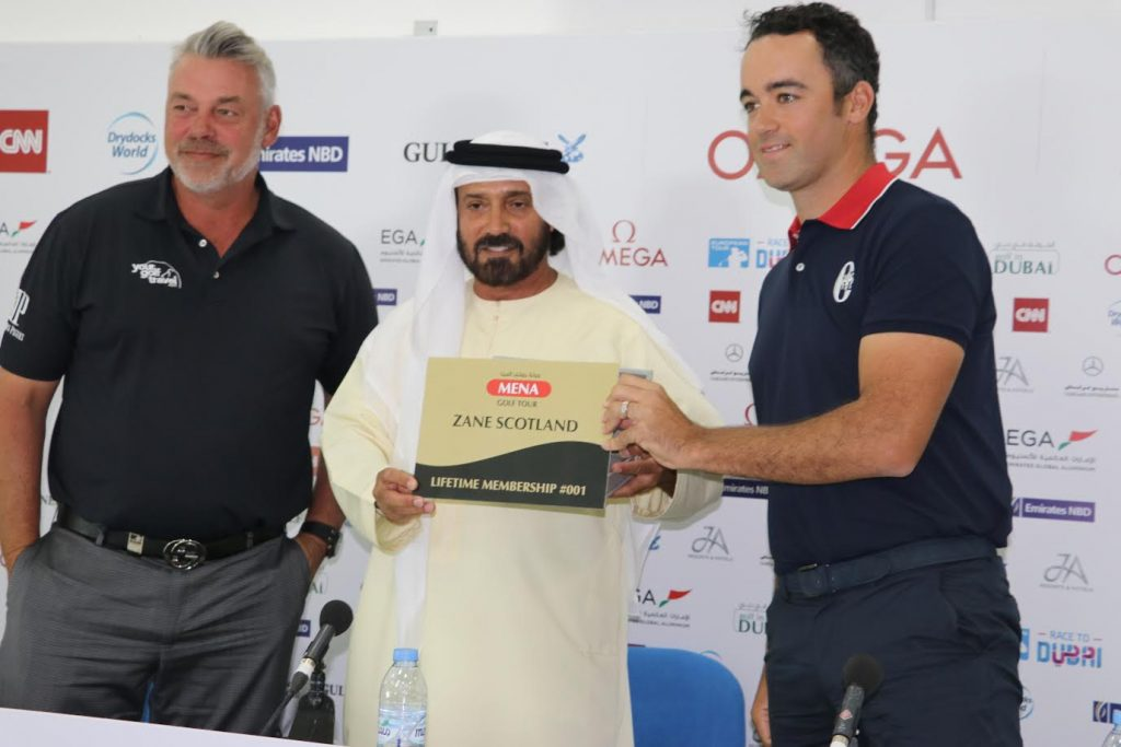 Open Champion Darren Clarke, Patron of the MENA Golf Tour, and Mohamed Juma Buamaim, chairman of the tour, honouring England's Zane Scotland, a 10-time winner on the tour, with the Lifetime Membership, at a press conference at Emirates Golf Club last Sunday.