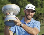 Dustin Johnson celebrates his third victory in succession in lifting the Walter Hagen Trophy (Photo - European Tour)